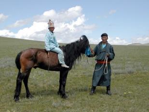 Winning stallion with jocky and trainer